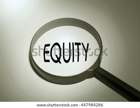 Magnifying glass with the word equity