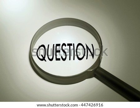 Magnifying glass with the word question. selective focus - stock photo