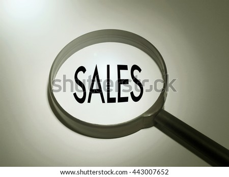 Magnifying glass with the word sales. Searching sales