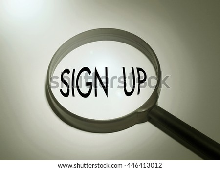 Magnifying glass with the word sign up