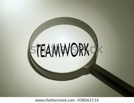 Magnifying glass with the word teamwork. Searching teamwork