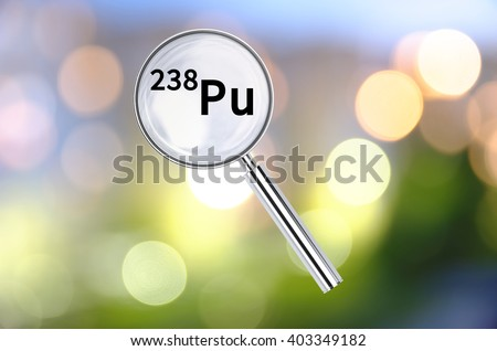Magnifying lens over background with text Plutonium-238, with the blurred lights visible in the background.