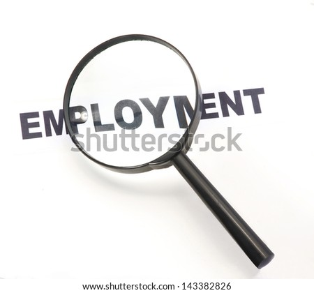 Magnifying on employment word. - stock photo