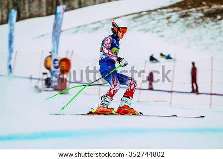 Magnitogorsk, Russia -  December 13, 2015: athlete male skier after finish of race downhill from mountains during Russian Cup in alpine skiing - stock photo