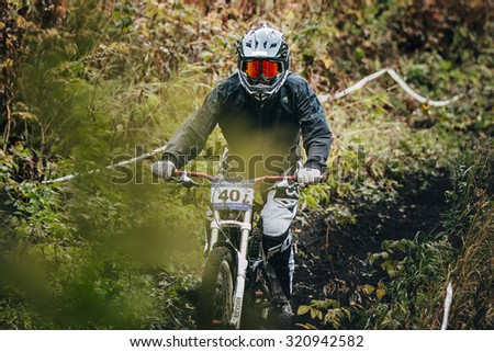 Magnitogorsk, Russia -  September 12, 2015: athlete rides on the mountain bike trail on earth during Urals Cup of downhill bike, Magnitogorsk, Russia -  September 12