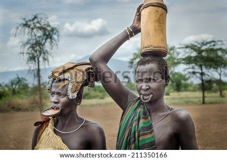 MAGO NATIONAL PARK, ETHIOPIA - AUGUST 10: two unidentified women from Mursi Tribe on August, 10, 2014. Mursi Women wear lip plates as a sign of beauty - stock photo