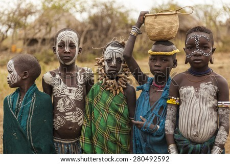 MAGO NATIONAL PARK, OMO VALLEY, ETHIOPIA - JANUARY 01, 2014: Unidentified children from Mursi tribe in Mirobey village.  - stock photo