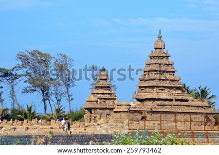 MAHABALIPURAM, INDIA FEBRUARY 8 2015: Shore Temple was built in the first half of the eighth century at the shore of the Bay of Bengal.It is one of the oldest structural stone temples of India. - stock photo