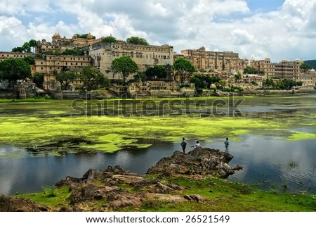 Maharajah Palace on lake shore in Udaipur, Rajasthan, India - stock photo