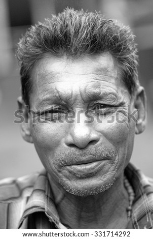 MAHARASHTRA, INDIA July 9, 2011: Old fisherman closeup, July 9, 2011, Portuguese port Vasai, Mumbai, Maharashtra; India, Southeast, Asia.