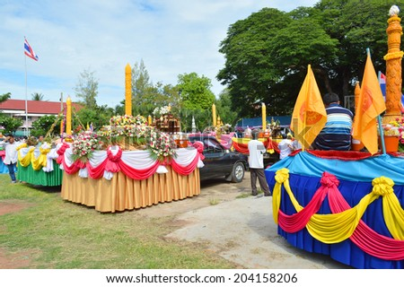 MAHASARAKHAM - JULY 10 : Thai people participate in Buddhist Lent festival parade at city hall plaza on July 10, 2014 in Mahasarakham, Thailand.