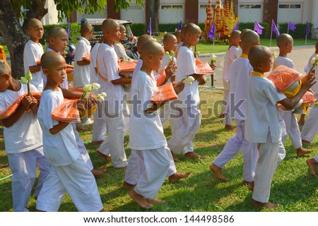 MAHASARAKHAM, THAILAND - APRIL 10 : Unidentified boys aged about 14 - 16 years old are participating in summer ordination ceremony on April 10, 2013 in city hall plaza, Muang, Mahasarakham, Thailand.