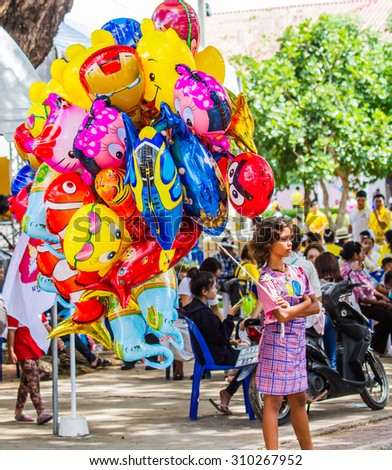 MAHASARAKHAM,THAILAND-AUGUST 22 : Various cartoon balloons available for sale to children in 150 year celebration of Mahasarakham province on August 22,2015.This balloon are favorite for children.