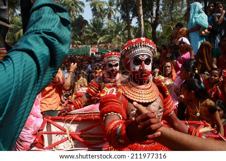 MAHE, INDIA - JANUARY 31 : Unidentified Theyyam artists perform during the annual festival at Palloor temple on January 31, 2010 in Mahe, India.Theyyam is a ritualistic folk art form of Kerala. - stock photo