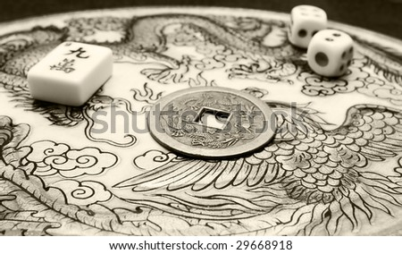 Mahjong item, dices, chinese lucky coin and oriental pattern background