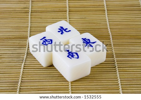 Mahjong tiles representing the four compass points in chinese - stock photo