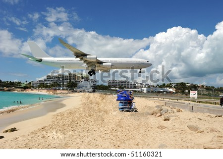 Maho bay in St Martin: one of the main attractions for plane spotters! - stock photo