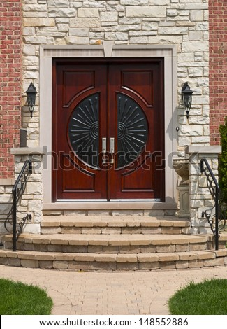 mahogany brown wooden front door - stock photo