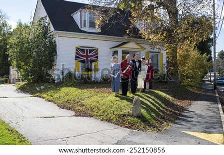 MAHONE BAY, CANADA -OCTOBER 9: Figures (Royal Family) at the annual scarecrow festival. Figures of different motives are placed in the streets all over the town. October 9, 2014 in Mahone Bay, Canada - stock photo