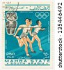 MAHRA - CIRCA 1968: A stamp printed in South Arabia, shows runners and the ancient statue of the American, series, circa 1968 - stock photo