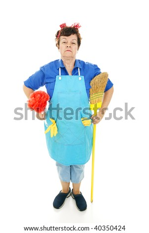 Maid standing at attention with her duster and broom.  Full body isolated. - stock photo