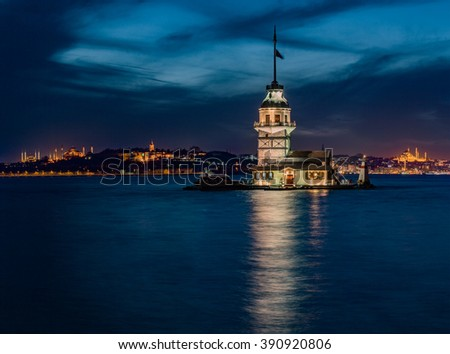 Maiden's Tower and The Old Town  with Topkapi Palace and Mosques at night in Istanbul Turkey - stock photo