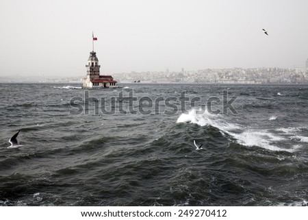 Maidens Tower and southwest wind storm in Istanbul - stock photo