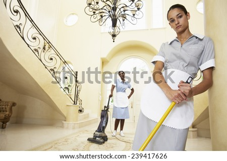 Maids Cleaning Lobby - stock photo