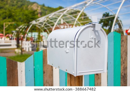 Mail boxes and an antique farm implement in a farming landscape - stock photo