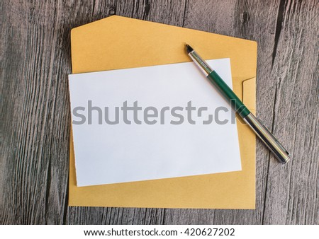 Mail concept with envelope and pencil. White page