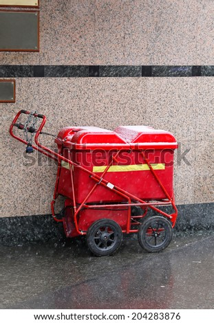 Mail delivery cart under snow in London