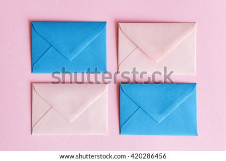 mail envelope or letter sealed on pink background - stock photo