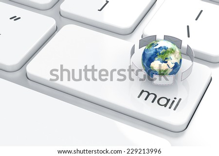 Mail envelopes with Earth on the computer keyboard. Email concept. Elements of this image furnished by NASA - stock photo