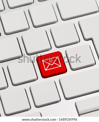 Mail keyboard button on red keyboard button - stock photo