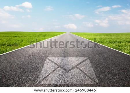 Mail, message symbol on long straight road, highway. Conceptual - post, shipping, parcel, e-mail,  - stock photo