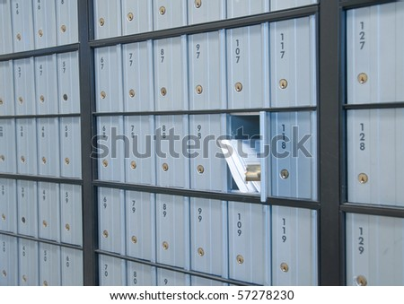 mail waiting in the u.s. grey/blue post office box