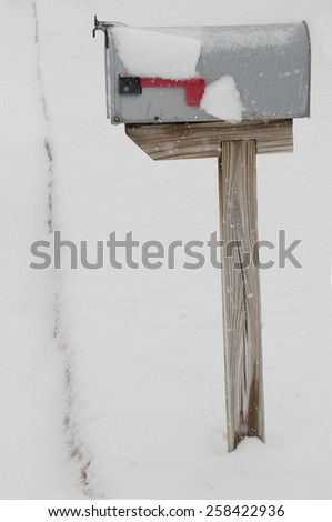 Mailbox buried in deep snow, soft focus