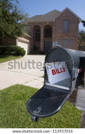Mailbox filled with monthly house bills - stock photo