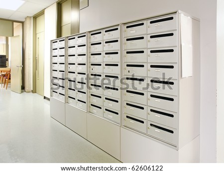 Mailbox in the hallway of a stark public office or school building. - stock photo