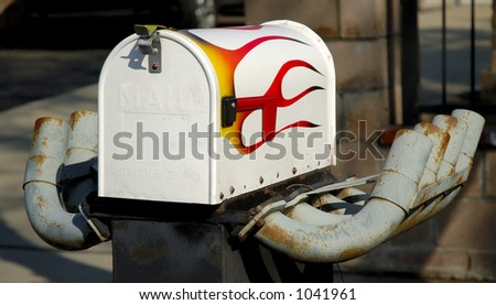 Mailbox with painted flames and exhaust pipes. Concept, fast, speed, speedy postal service. - stock photo