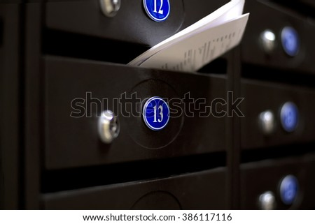Mailboxes in an apartment house. The letter in the mailbox - stock photo
