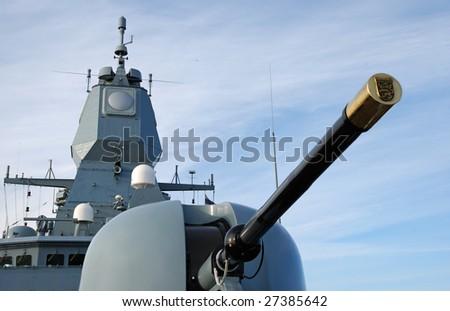 Main artillery cannon on-board a frigate. - stock photo