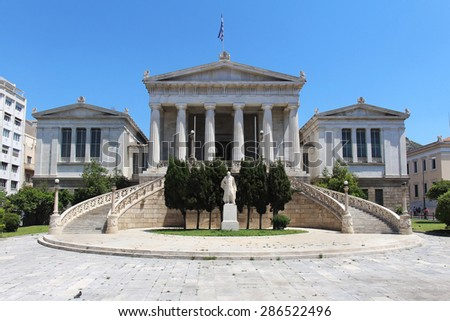 Main building of Athens National Library with Greek flag on roof