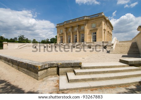 Main building of the Petit Trianon in Versailles Palace, Paris France. The Petit Trianon is a small chateau, it's builted by Gabriel for Louis XV. - stock photo