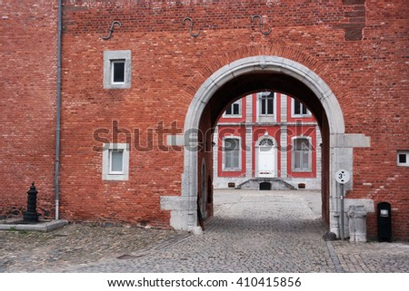 Main building of the Stavelot Abbey seen through a archway. The Abbey of the Prince-Bishops of Stavelot, Belgium.