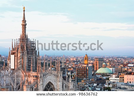Main cathedral panorama at dusk in Milan - stock photo