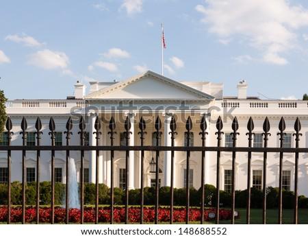 Main entrance of White House seen through railings at 1600 Pennsylvania Avenue Washington DC - stock photo