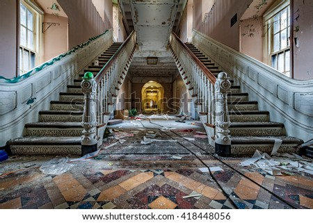 Main entrance with symmetrical stairs of an abandoned psychiatric hospital (demolished in 2015) - stock photo