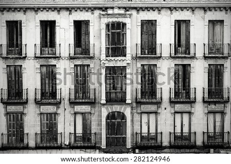 Main facade of an old abandoned building in the old town of Avila facing the defensive wall. - stock photo