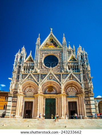 Main facade of the cathedral in Siena, Italy - stock photo